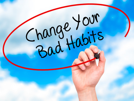 52357697 - man hand writing change your bad habits  with black marker on visual screen. isolated on sky. business, technology, internet concept. stock photo